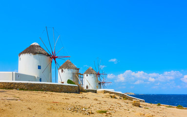Famous old windmills on the seashore in Mykonos Island, Greece. Space for your own text