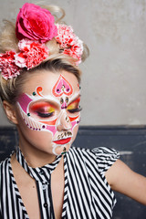 Young beautiful woman with skull makeup. Mexican day of the dead