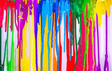 colorful of paint are dripping by in opposite directions