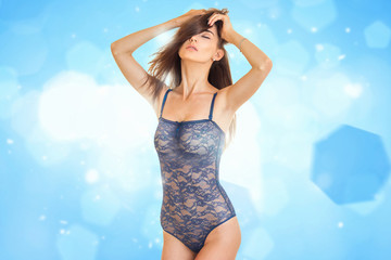 passionate girl in lace blue body lingerie