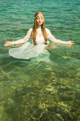 Young woman standing in the ocean
