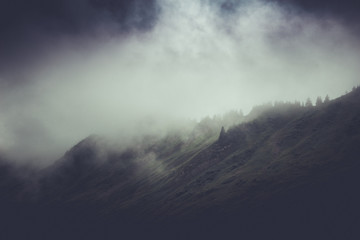 Moody stormy mountain landscape with cloud