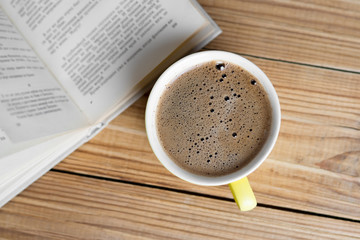 Coffee mug and book top view