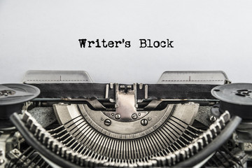 Writers Block typed text on a Vintage Typewriter, old paper, close-up. The writer's tool