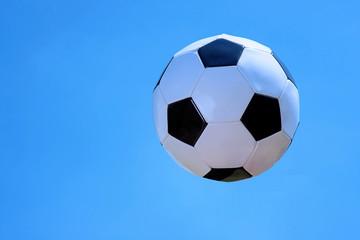 Soccer ball on sky background