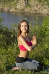 Young beautiful woman doing peacefully yoga
