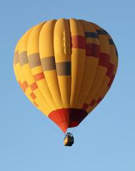 A Hot Air Balloon Soars in a Blue Sky