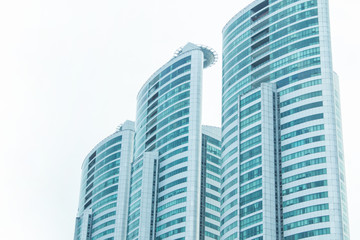 Modern residential skyscrapers for real-estate buy or rent in futuristic city.