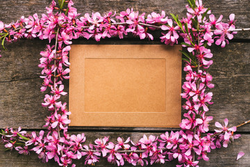 Frame photo with pink flower on table