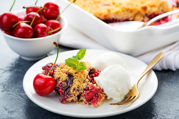 Crumble with cherry and  vanilla ice cream.