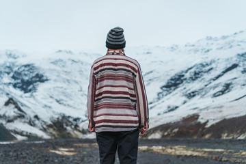 Man standing in road in winter