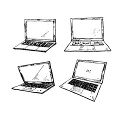 The set of four hand drawn different laptops isolated on a white background. Technology theme.