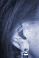 Deaf woman hearing aid ear
