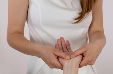 Acupressure. Therapist doing healing treatment treatment on woman's hand . Alternative medicine, pain relief concept