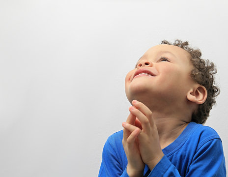little boy praying stock photo