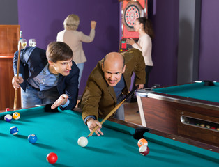 Happy people having pool game