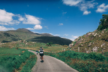 People riding bicycles on the scenic roads of Black Valley in county Kerry, Ireland