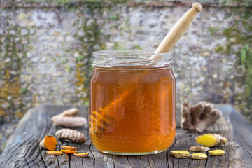 Natural Spa healthcare Ingredients . - Turmeric curcuma, ginger, and honey for skin care. on exterior old flint, wall background