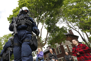 Riot police prepare for a protest march during the G7 Summit in Quebec City