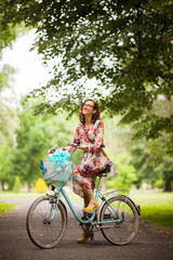 girl with vintage bicycle