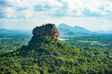 Spectacular view of the Lion rock surrounded by green rich vegetation. Picture taken from Pidurangala Rock in Sigiriya, Sri Lanka. Fotoväggar
