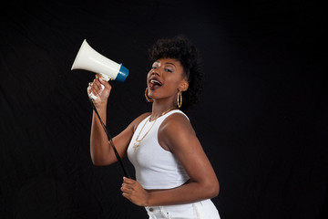 Happy Black woman with a megaphone
