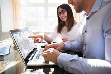 Two Businesspeople Analyzing Gantt Chart