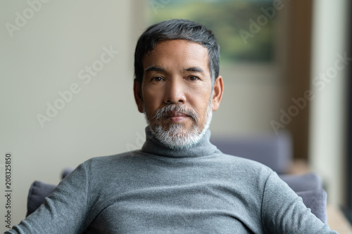 fa9800ccdbb Portrait of attractive mature asian man retired with white stylish short  beard sitting on couch at coffee shop cafe. Close up of old handsome  businessman or ...