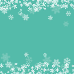 Christmas snow background with scattered snowflakes falling in winter