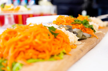 appetizer of marinated vegetables on a banquet table