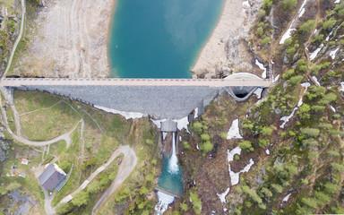 Aerial view of the dam of the Lake Fregabolgia, an Alpine artificial lake. Italian Alps. Italy
