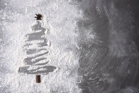 Flour on a baking sheet in a Christmas tree shape