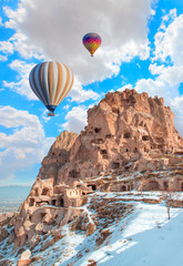 Poster Turquie Hot air balloon flying over rock landscape at Cappadocia Turkey