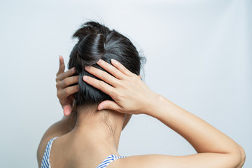 rear view of women tightening the hair, lifestyle concept
