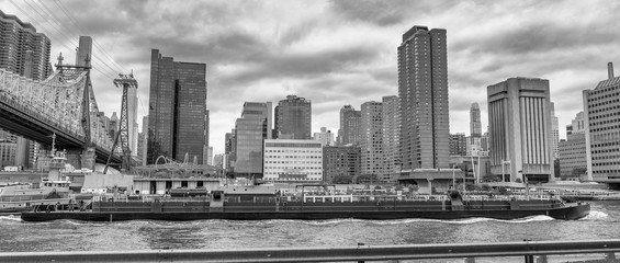 Manhattan and East River view from Roosevelt Island on a cloudy day