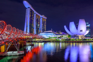 Singapore cityscape, Southeast Asia. Marina bay buildings and skyscrapers of downtown reflected in the Harbor. Singapore architecture skyline by night. Night scene waterfront.