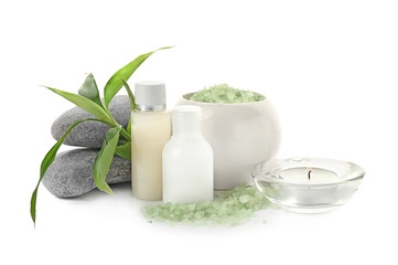 Spa composition with candle and toiletries on white background