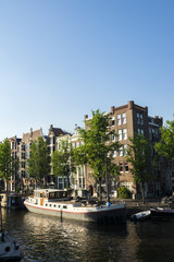 On the banks of the canals of Amsterdam, magnificent boats are transformed into houses