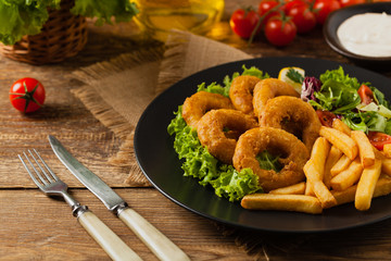 Roasted squid rings with fries.