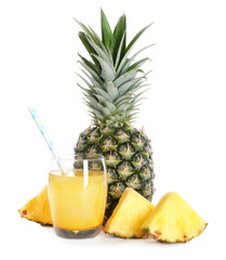 Fresh pineapple and glass with juice on white background