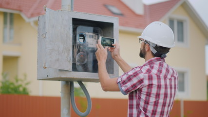 The inspector takes pictures of the meter reading