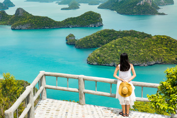 Woman facing stunning view at small islands in Thailand