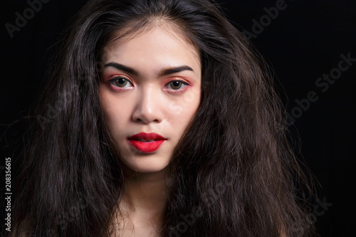 cf4553a1bed Attractive girl has damaged hair. Gorgeous girl painted beautiful a red  mouth. Glamour lady has a nice face and skin