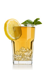 glass full of ice tea with lemon slices and tea leaves on white background