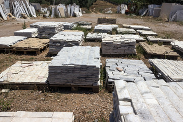 Building material shop.  Decorative building stone, marble and granite lie on the pallet.
