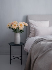 Flowers next to bed
