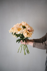 bouquet of flowers in hands, peonies