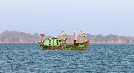 Ha Long Bay, Vietnam-December 18, 2015. Vietnamese fishermen fishing on December 18, 2015 at Ha Long Bay of north Vietnam.