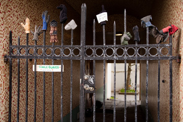 Homeless gloves sitting on a gate as art in iceland