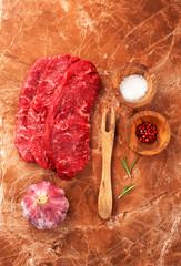 Fototapete - Raw marbled meat Steak and seasonings on dark marble background